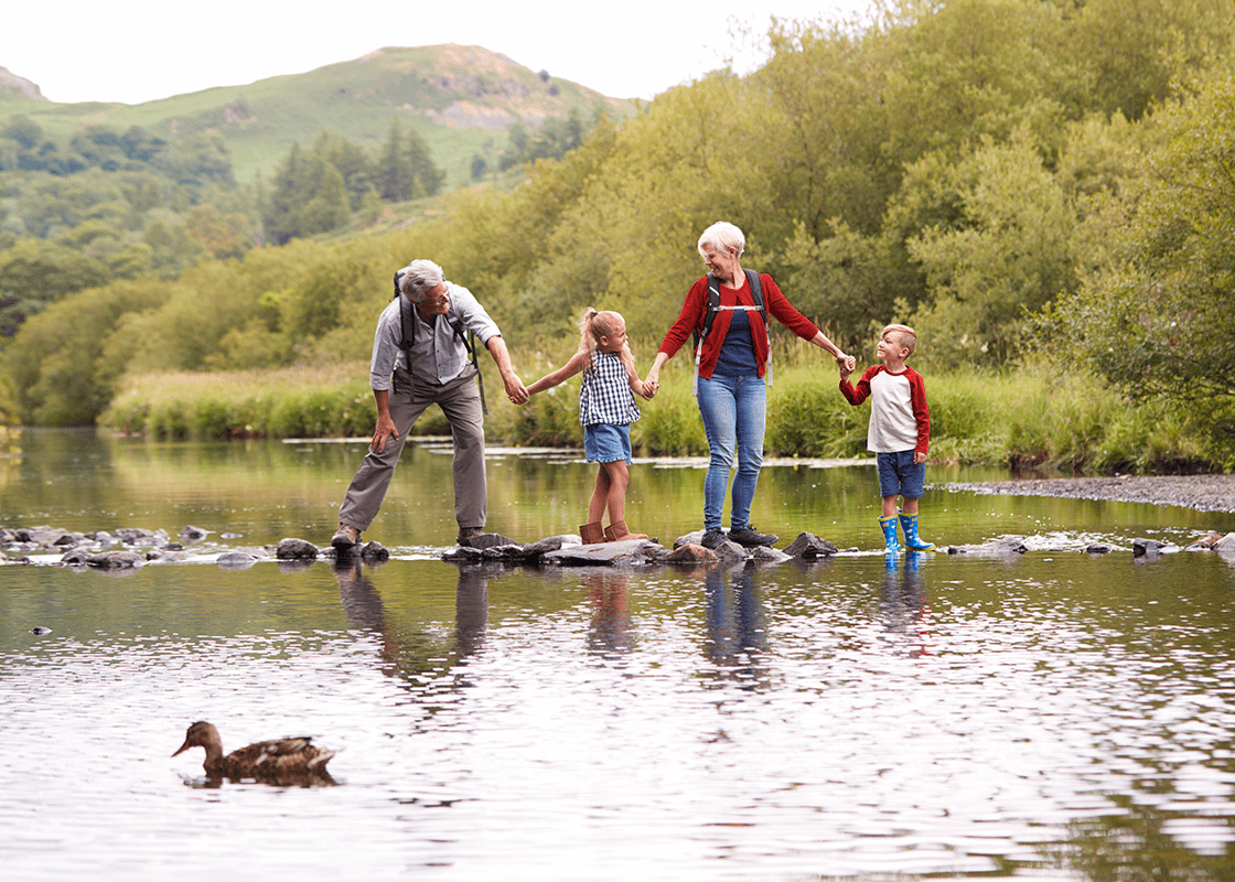 Family on stepping stones
