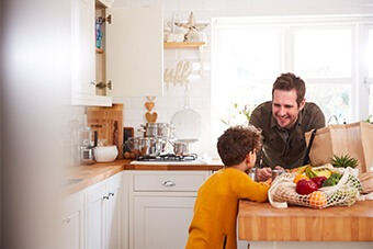 Man in kitchen with son